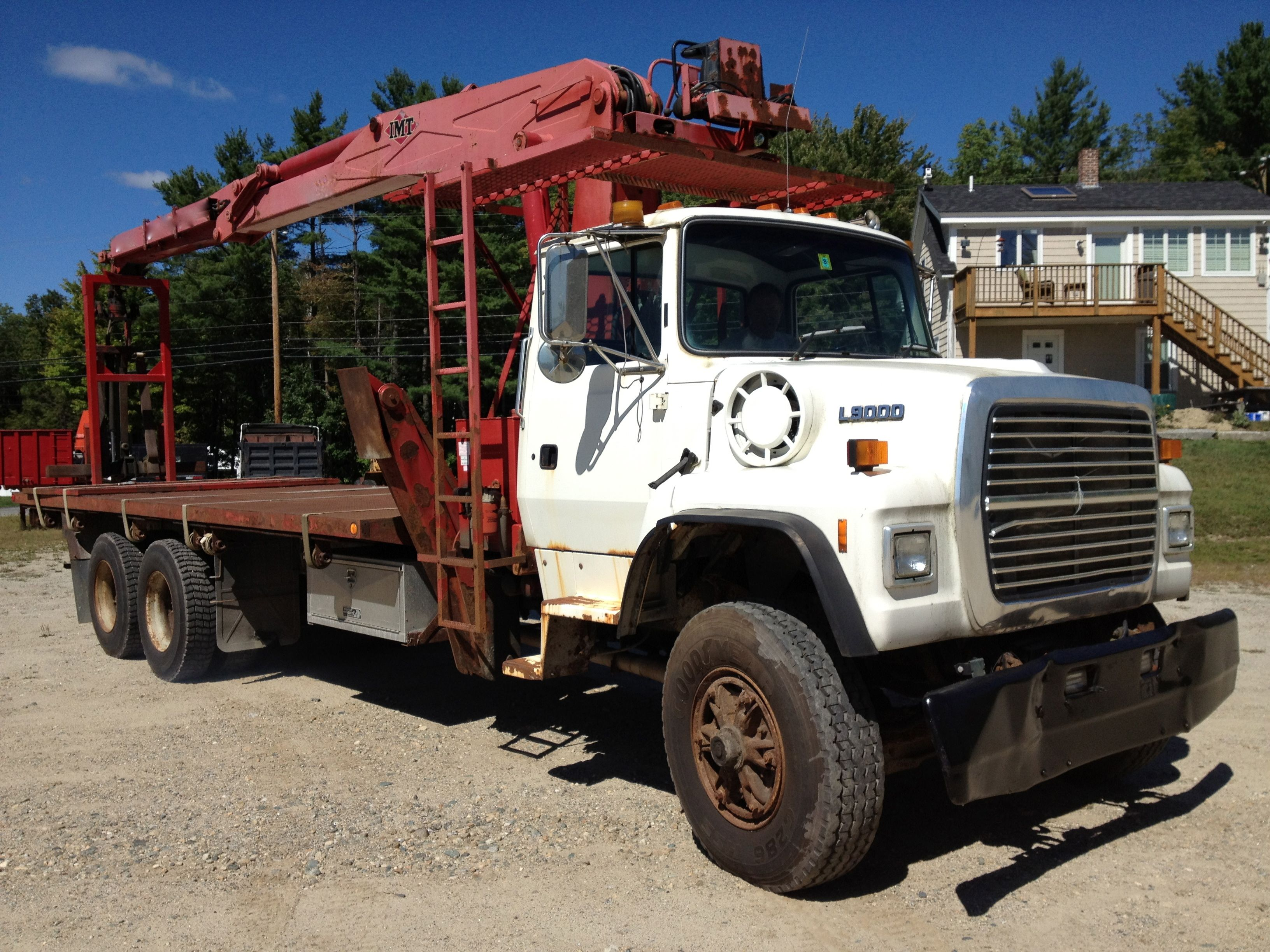Ford l9000 with imt 13034 cran heavyhauling