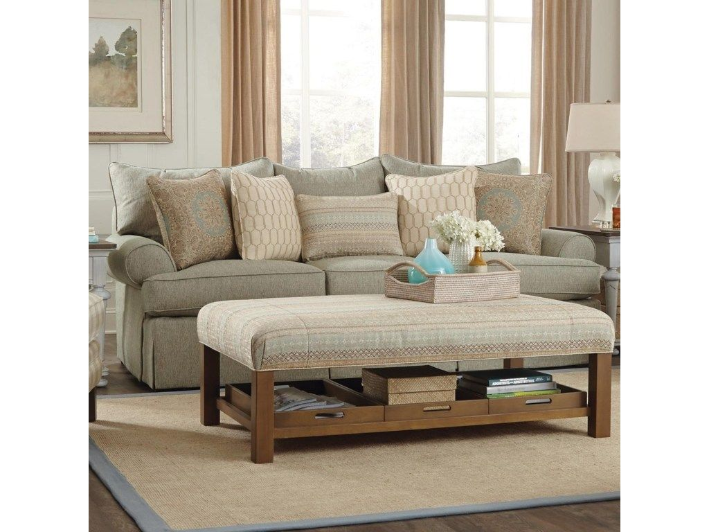An Array Of Cozy Pillows Add To The Comfort Of This Sofa