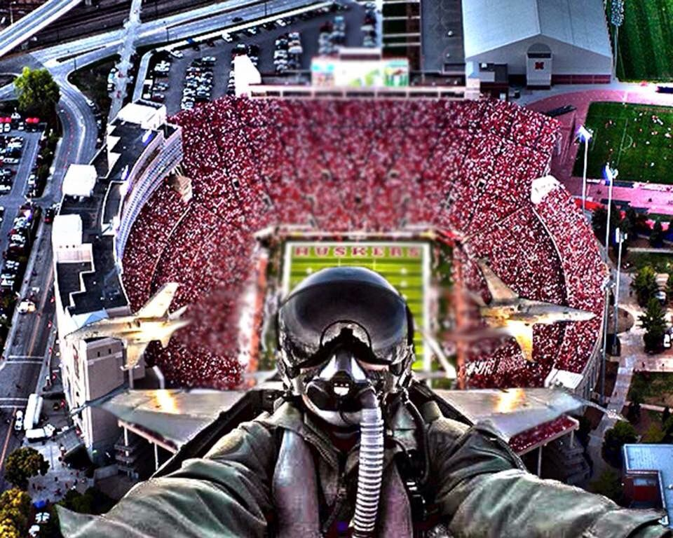 Jets over memorial stadium with images nebraska