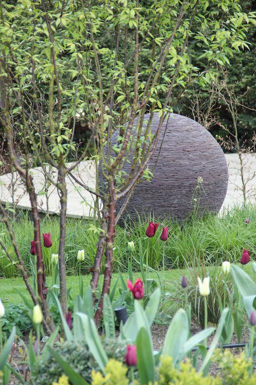 Planting design complementing a James Parker sculpture in ...