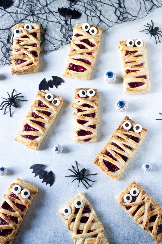 Raspberry Halloween mummy pies are a fun and easy way to make spooky - halloween entree ideas