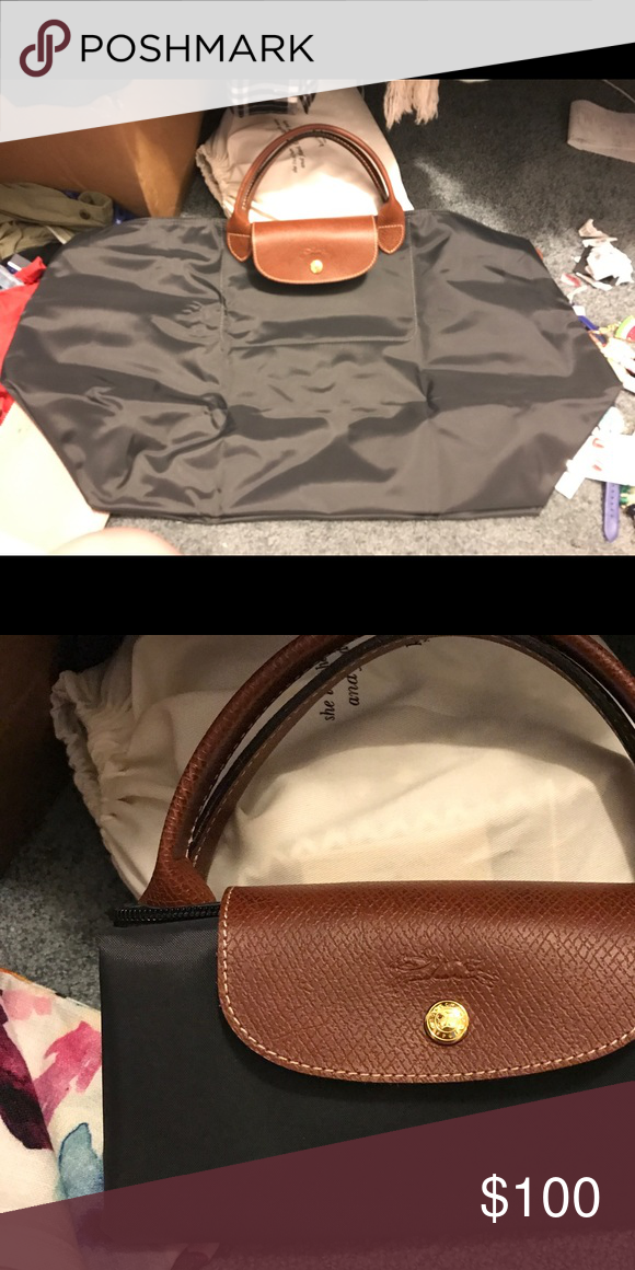 Longchamp bag Large longchamp bag in charcoal grey! It s a very dark grey  almost black but still very cute! Never used, in perfect condition! Longchamp  Bags 60fcc68049