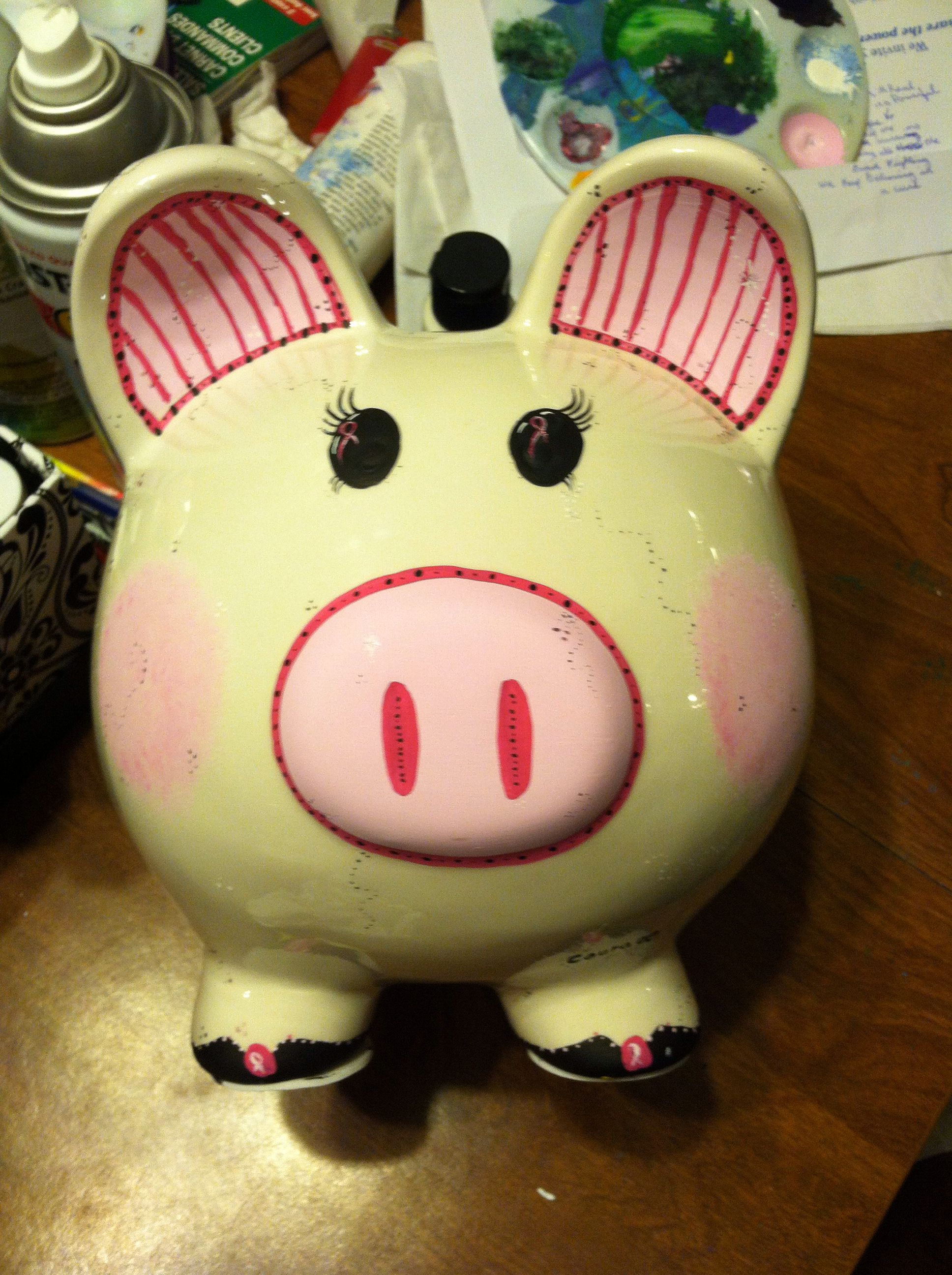 Breast cancer awareness painted piggy bank face