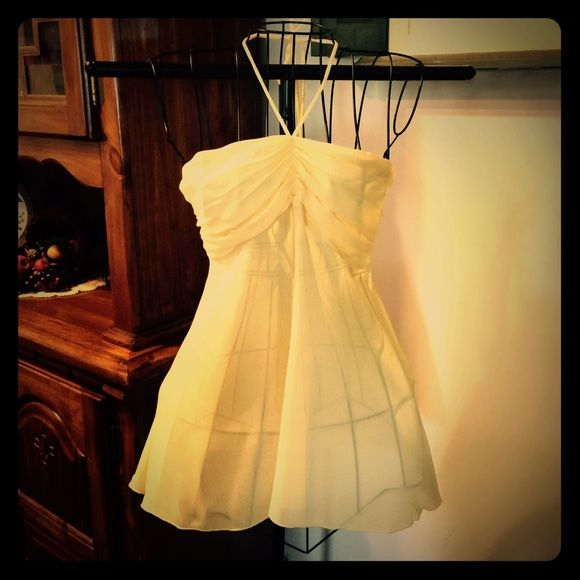 Cute Halter Top NWOT Adorable chiffon flowy halter top. Great for spring and summer. Would look cute with a denim jacket. Perfect for shorts or jeans. Never worn.NO TRADESOFFLINE TRANSACTIONS Karlie Tops