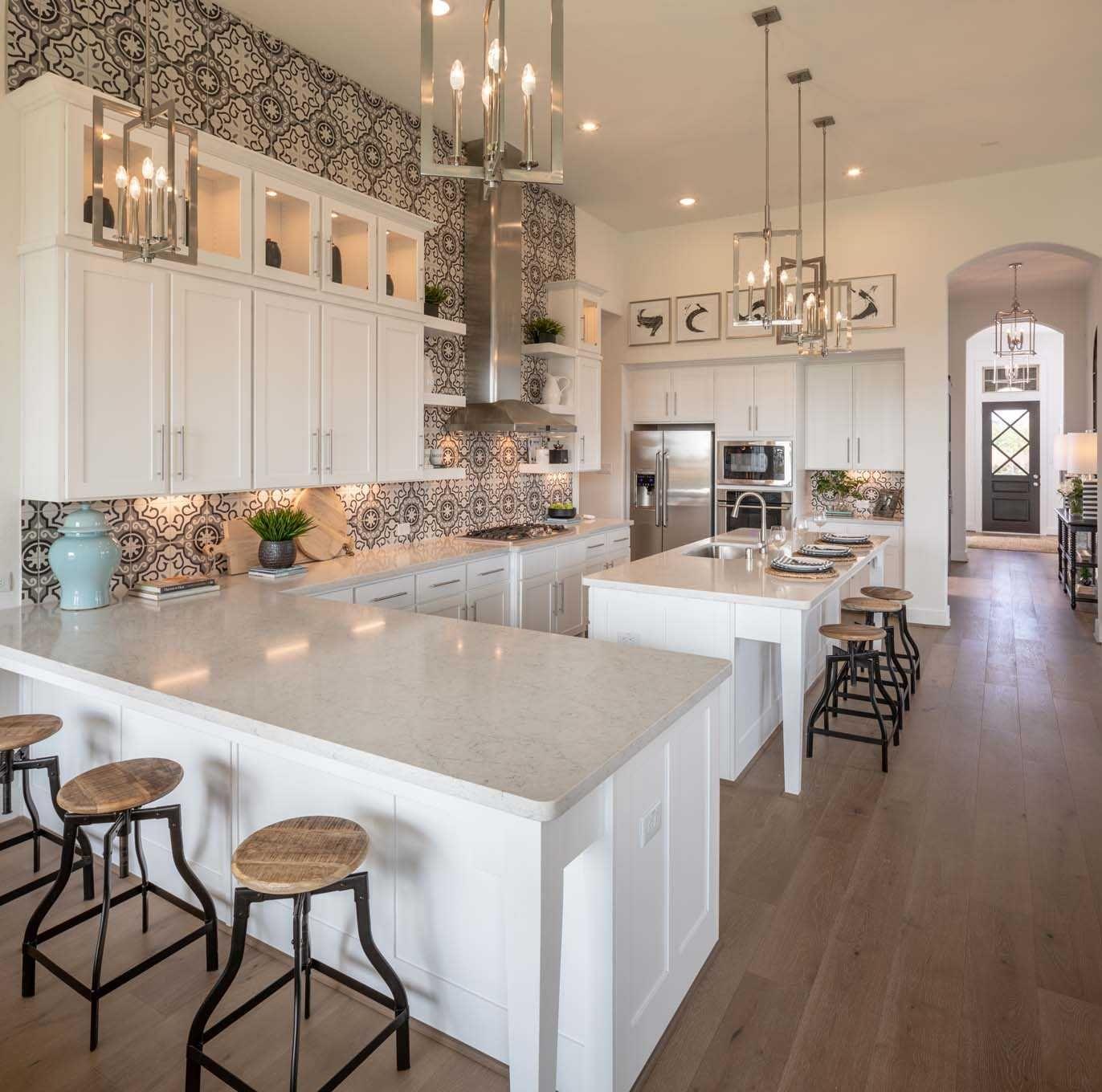 Kitchen in Highland Homes 200 Plan at 2703 Coastal Trail