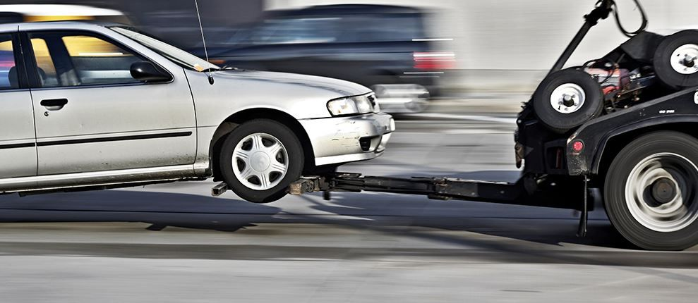 Getting towing service can really be a relief. I like the way the front wheels are not touching the ground in this image. It means the transmission will not arrive at the shop with any damage.