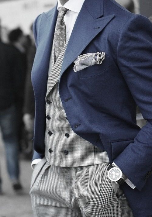 Outfit with blue jacket, with a matching grey double breasted vest and  pants with grey printed tie and grey pocket square