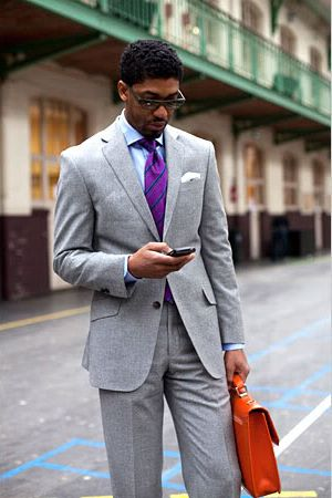 Purple tie, leather brief...nice contrast.