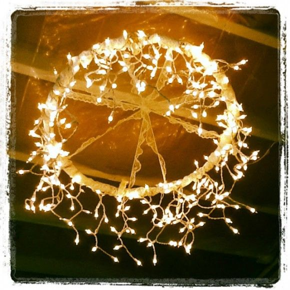 Project: hula hoop chandelier with Christmas lights. Use different size hoops for multi-level. Cheap! Under $15.