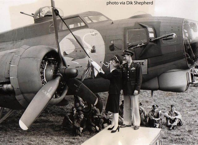 B-17G Swoose II, with Margo Kurtz about to break a bottle of champagne( suspended from the propeller blade) and break it on the propeller boss. Her husband, Lt. Col. Frank Kurtz, is standing next to her.