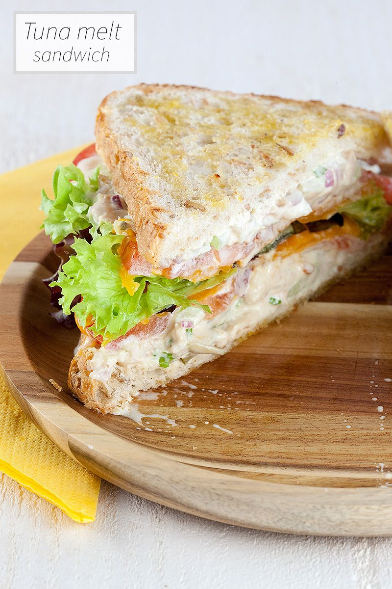A sandwich with homemade classic tuna salad, freshly grated mild cheddar cheese, fresh salad and tomatoes. Ready in 15 minutes, recipe for 2 people.