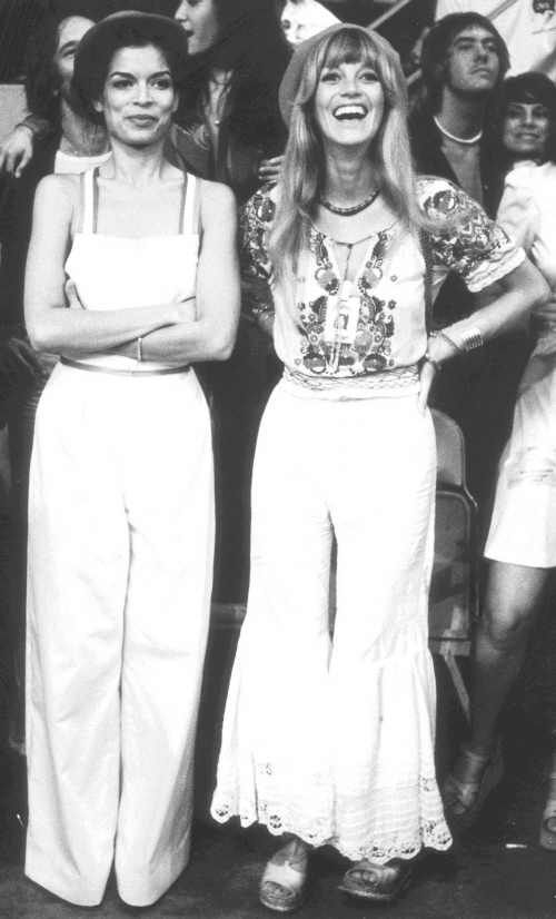 My husbands mother looking divine! Bianca Jagger and Krissy Wood at The Rolling Stones' live performance. 1975.
