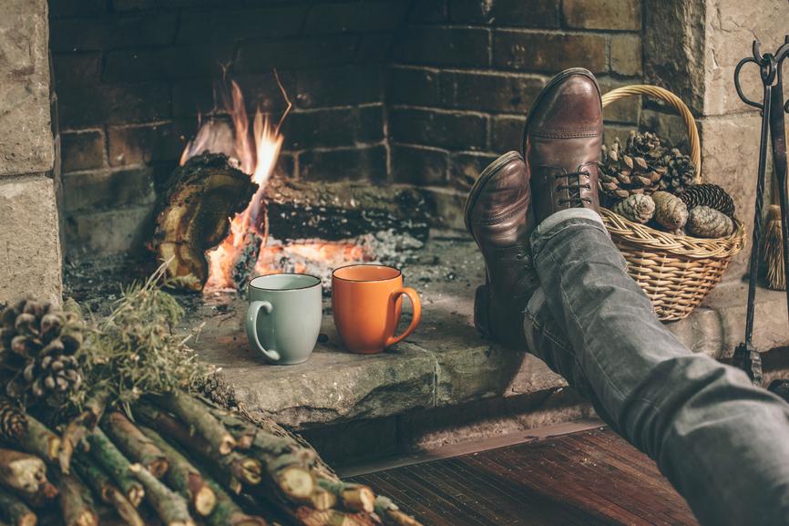 coffee cups and feet near fireplace