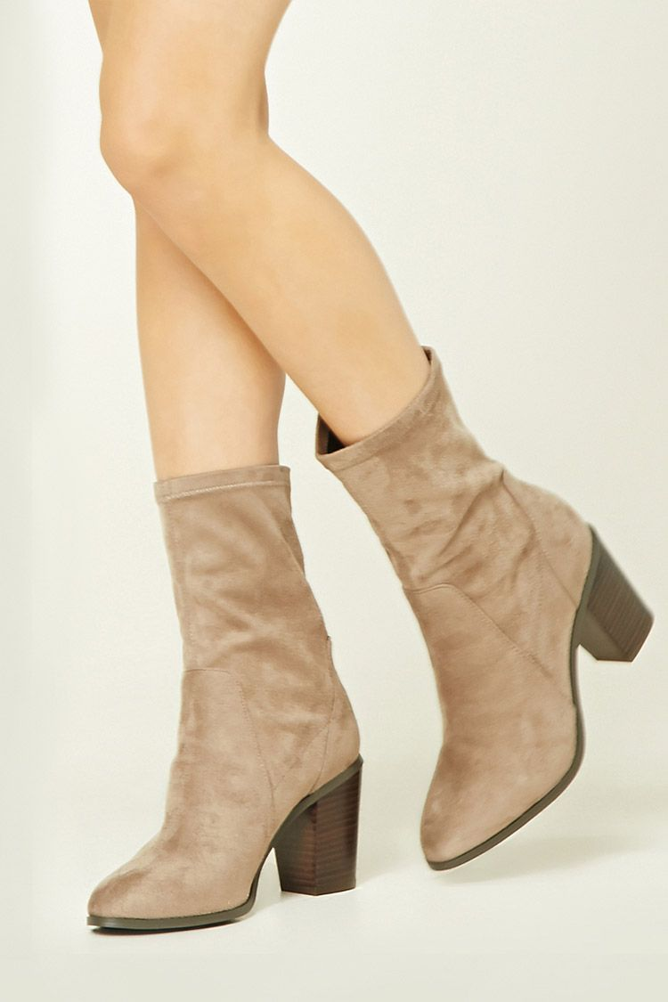 4c55e04bc A pair of faux suede sock boots featuring a slightly pointed toe and a  block heel.