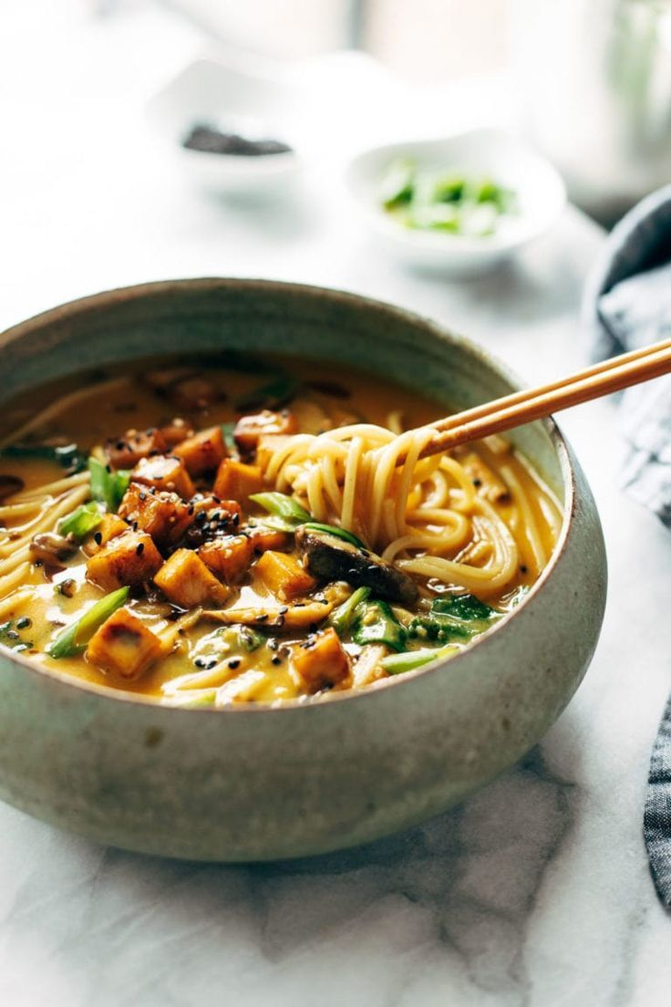 Coconut Curry Ramen with a creamy golden broth, pan-fried vegetables, cubes of golden brown tofu, and steamy delicious ramen noodles. Bonus: it's vegan! #ramen #vegan #curry | pinchofyum.com