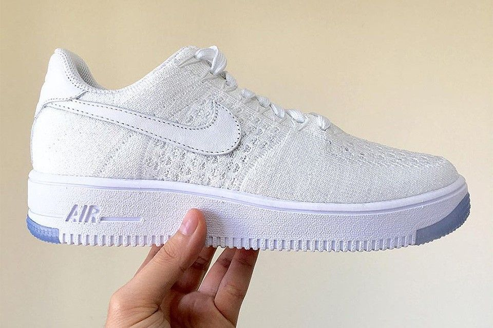 brand new 0eab3 eddbc Today we take a first look at Nike s latest amalgamation, an Air Force 1  Low decked out in the Swoosh s signature Flyknit material. Coming in tonal  white, ...