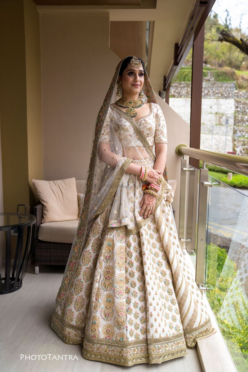 A Bride In An Ivory And Gold Lehenga Bridalwear Indian Bridal Dress Indian Bridal Outfits Bridal Lehenga Collection