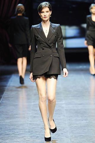 Dolce Gabbana Fall 2010 Fashion Trends: Menswear for Women - the peekaboo lace edging on the skirt makes it decidedly sexy.