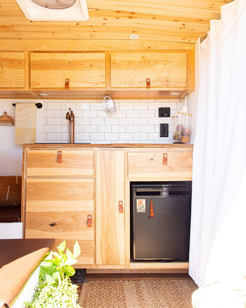 A 55 Square Feet Converted Van Is So Gorgeous It S Like A Minimal Modern Woodsy Cabin On Wheels In 2020 Converted Vans Van Home Kitchen Dining Room