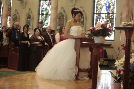 Kneeling At The Church During Your Quinceanera Mass