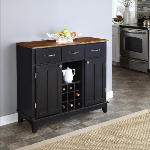 Home Styles 5100-0046 Buffet of Buffets Cottage Wood Top Buffet Server, Black Finish, 41-3/4-Inch  This large buffet server is constructed of hardwood and wood products in a black finish with a cottage wood top. Features three utility drawers and two wood framed cabinet doors with an adjustable shelf for plenty of inside storage. Center wine storage area can be removed for open storage if desired. Brushed steel hardware. The cabinet is equipped with adjustable floor levelers. Buffet ..