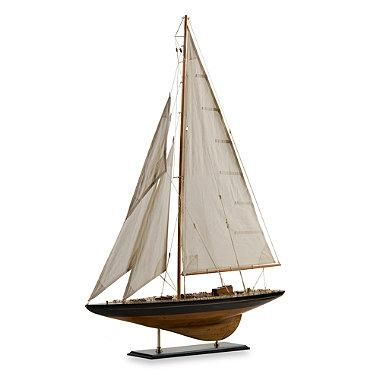 This meticulously handcrafted and exquisitely detailed wood model sailboat with canvas sails is perfect for injecting eye-catching, maritime décor to your home's interiors. A great way to enhance the look of any nautical-themed space in your home, too