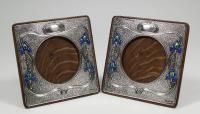 A pair of Edward VII silver and enamelled square photograph frames of Art Nouveau design, each 6.5ins square (to hold pictures 3.5ins diameter), by Zimmerman, Birmingham 1903/4