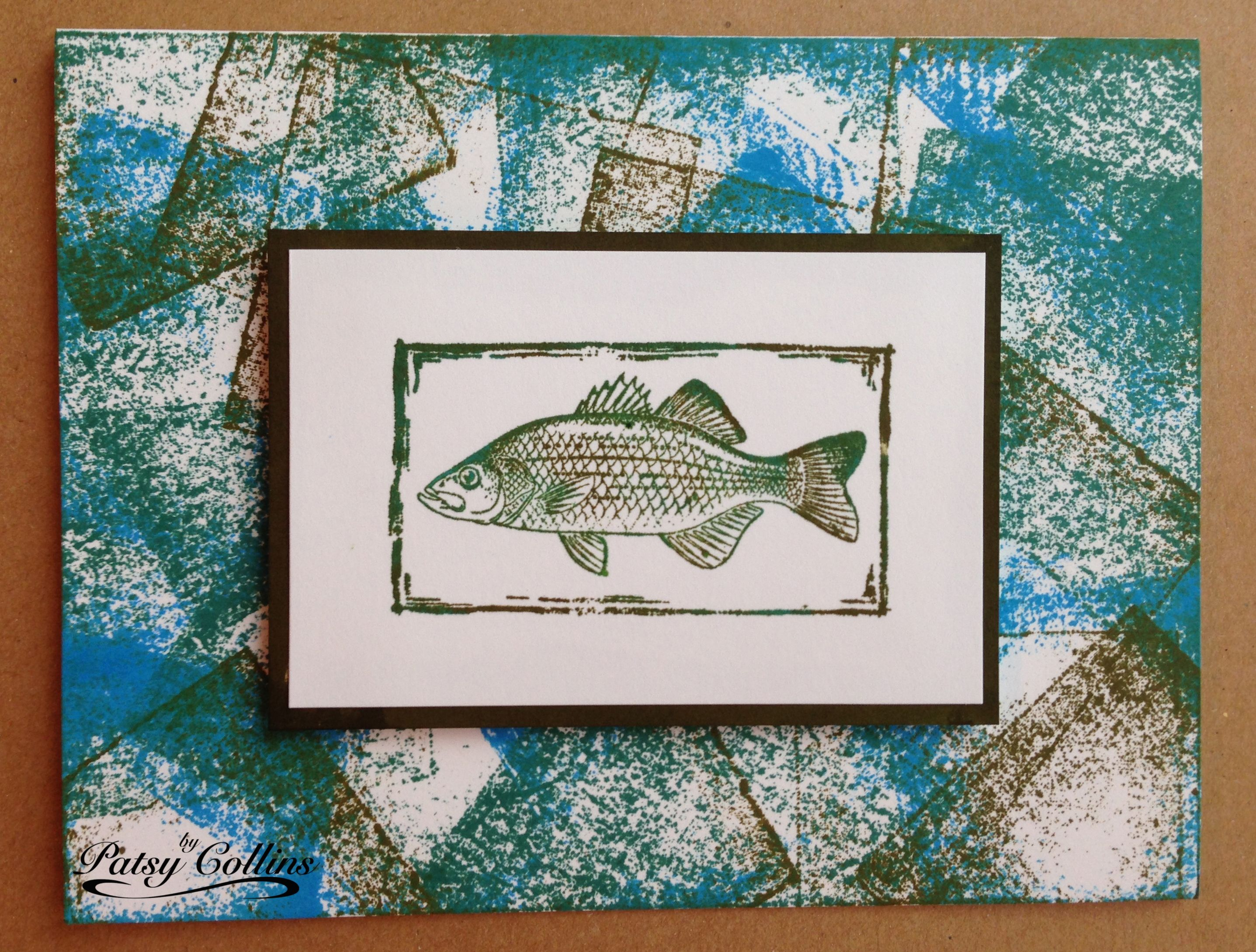 "By Patsy Collins. Ink fish stamp (Stampabilities ""White Bass"") with blue, green & brown inks. Stamp on small white cardstock panel. Adhere to black mat. Make background on card front by ""stamping"" Distress ink pads direct-to-paper, overlapping the squares. Pop up image on card."