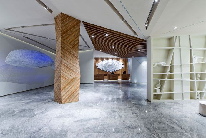 Chinese boutique hotel skytel cladding columns reception for Column designs for interior
