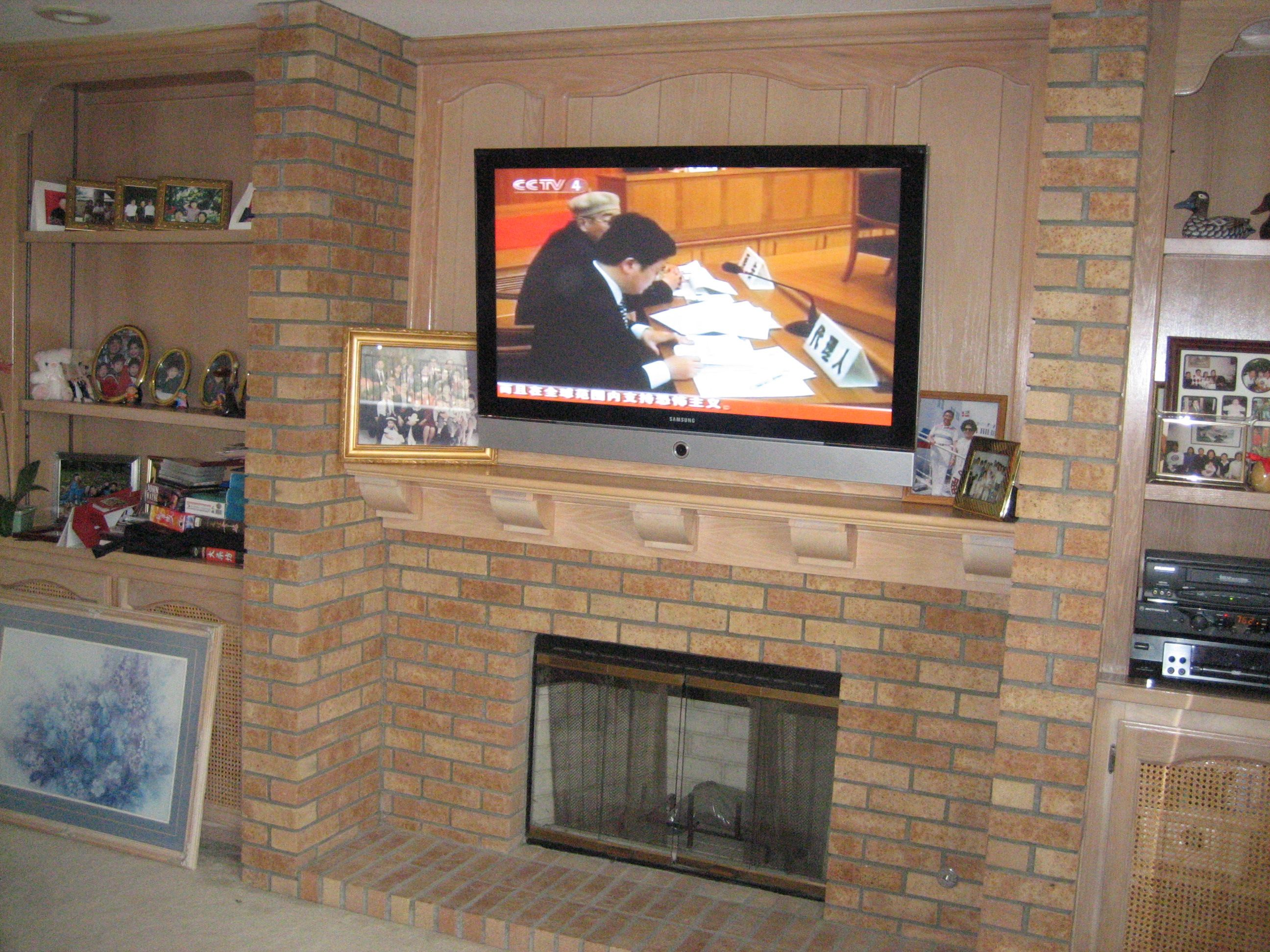 Add a 60 tv over a brick fireplace tv installation cost for Tv over fireplace