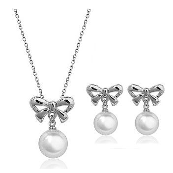 Pearl and 18k white gold plated bow pendant necklace and matching pierced or clip on earrings.