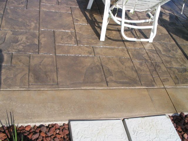 Stamped Concrete Patio With Porcelain Grey, Medium Grey And Smoky Beige  Colors