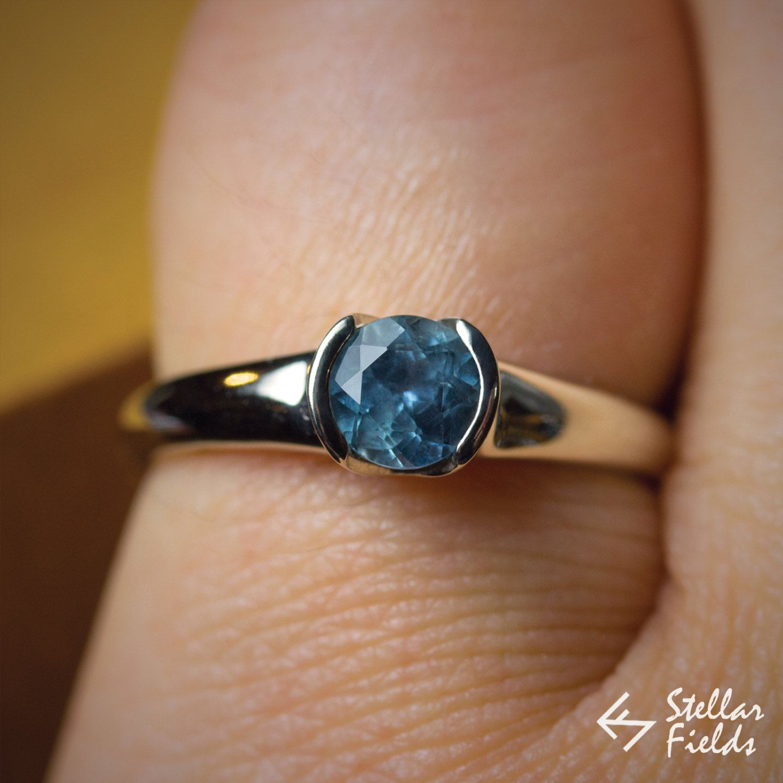 round blue montana sapphire bezel ring modern minimal ethical