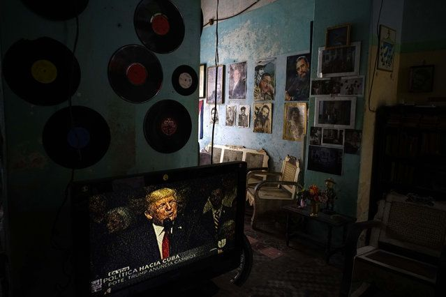 A television set shows U.S. President Donald Trump announcing his new Cuba policy, in a living room decorated with images of Cuban leaders at a house in Havana, Cuba, Friday, June 16, 2017. Trump declared he was restoring some travel and economic restrictions on Cuba that were lifted as part of Barack Obama's historic easing. (Photo by Ramon Espinosa/AP Photo) #cubanleader A television set shows U.S. President Donald Trump announcing his new Cuba policy, in a living room decorated with images of #cubanleader