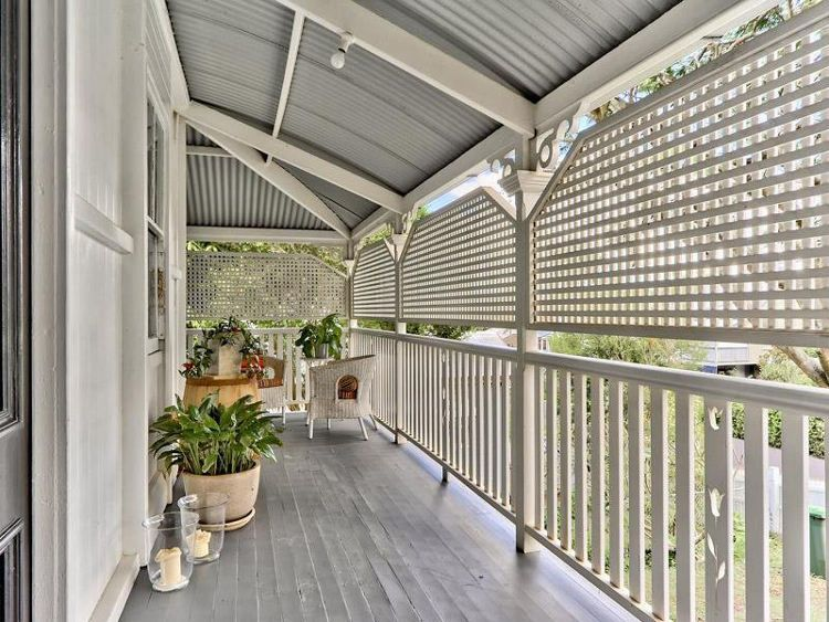 Queenslander verandah typical lattice with a tin roof for Front door queenslander