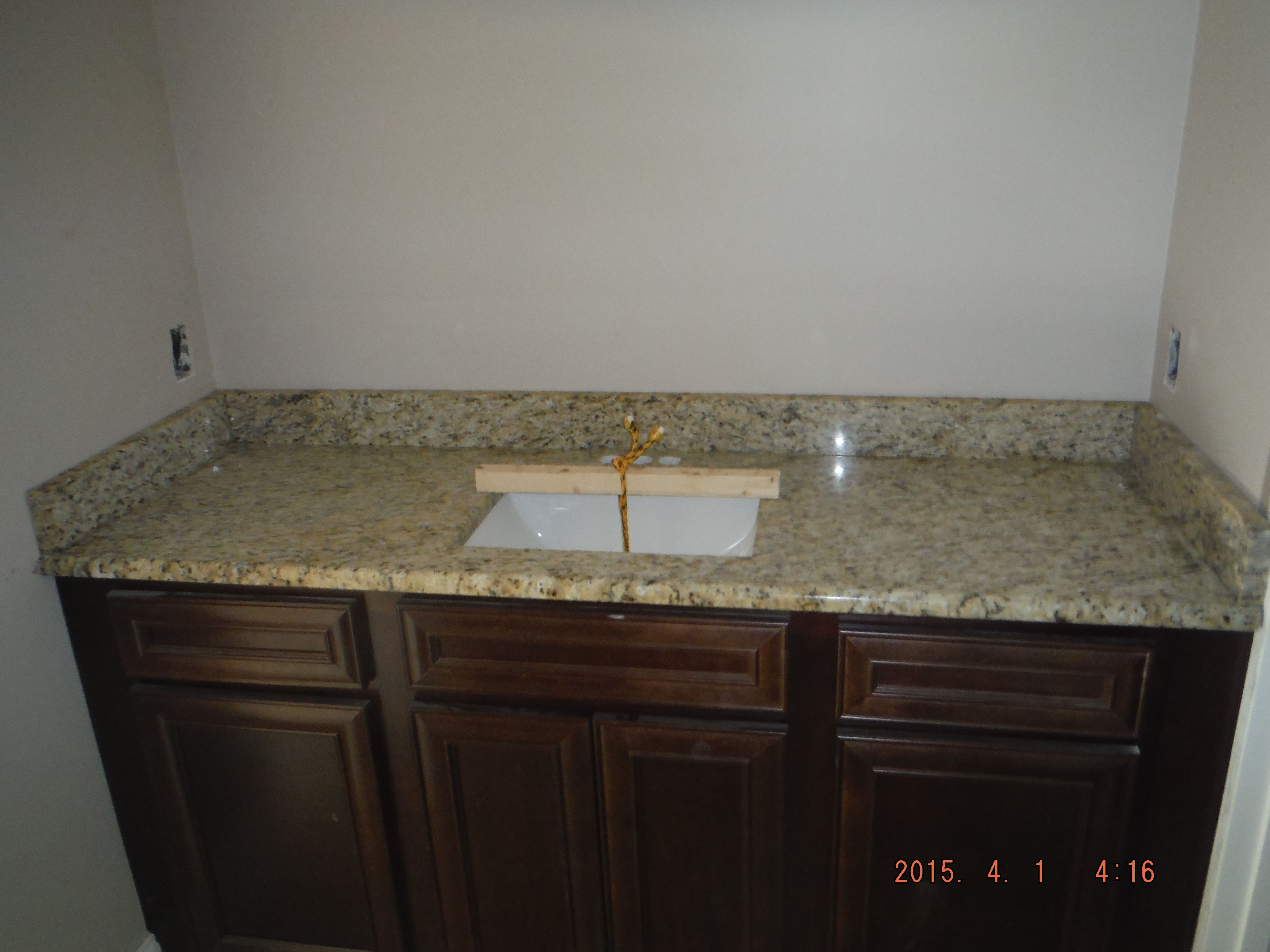 giallo ornamental granite kitchen countertop and bathroom vanity install for the maplewood project knoxvilles stone