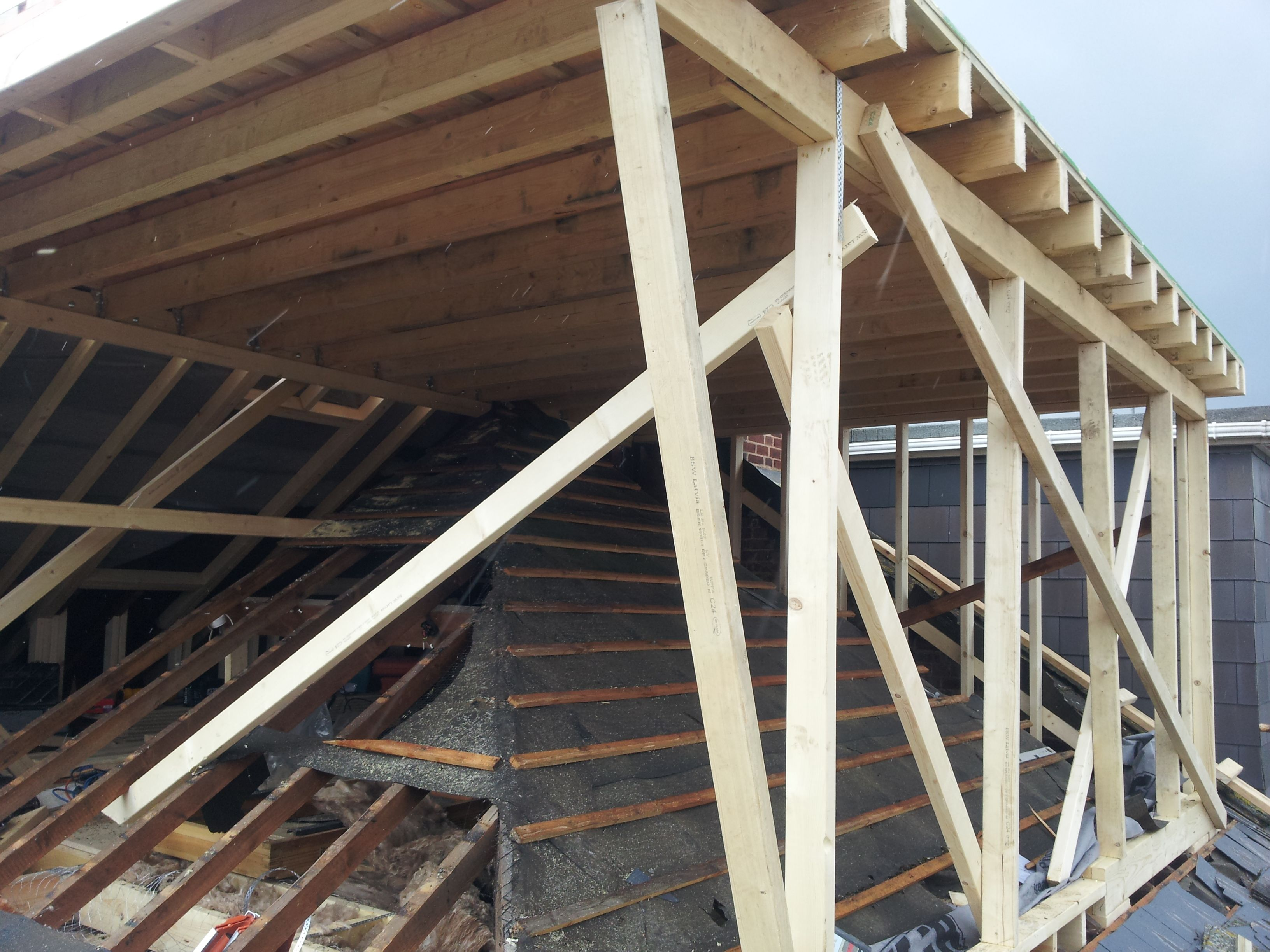 Hip-to-gable loft conversion mid construction. Flat roof ...