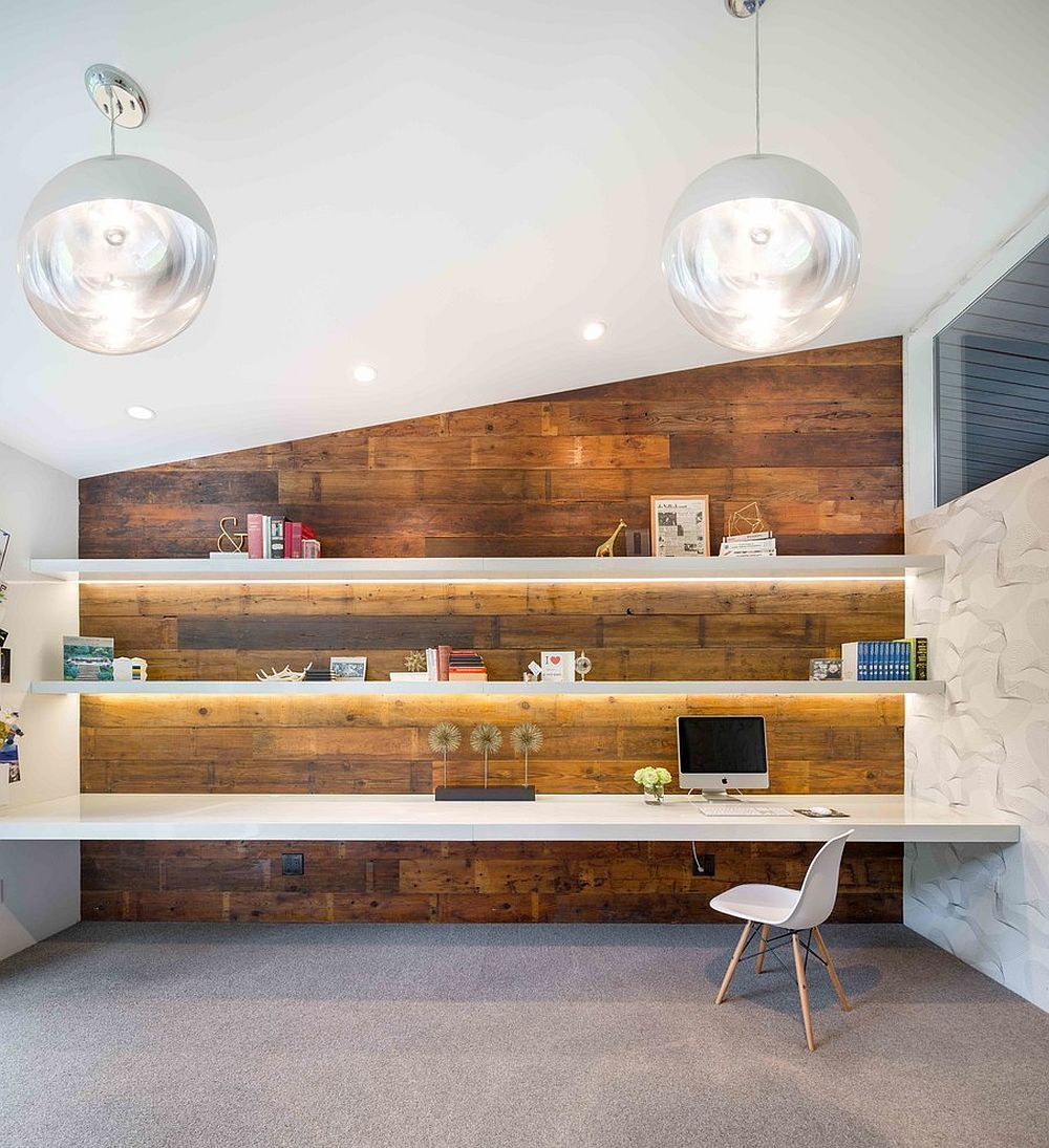 Gorgeously Lit Shelves And Reclaimed Wood Wall Create A Stunning Midcentury Modern Home Office From Modern Home Offices Home Office Design Modern Home Office