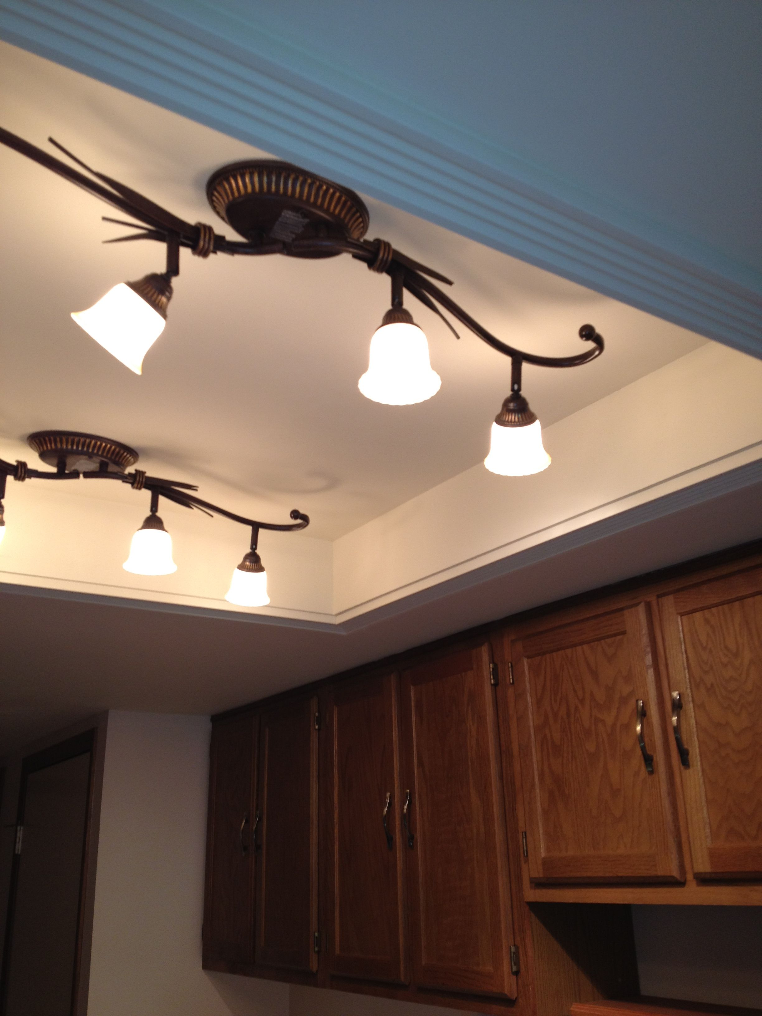 Convert that ugly recessed, fluorescent ceiling lighting in your kitchen to a beautiful trayed