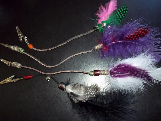 Feathered roach clips for your hair or rearview mirror...