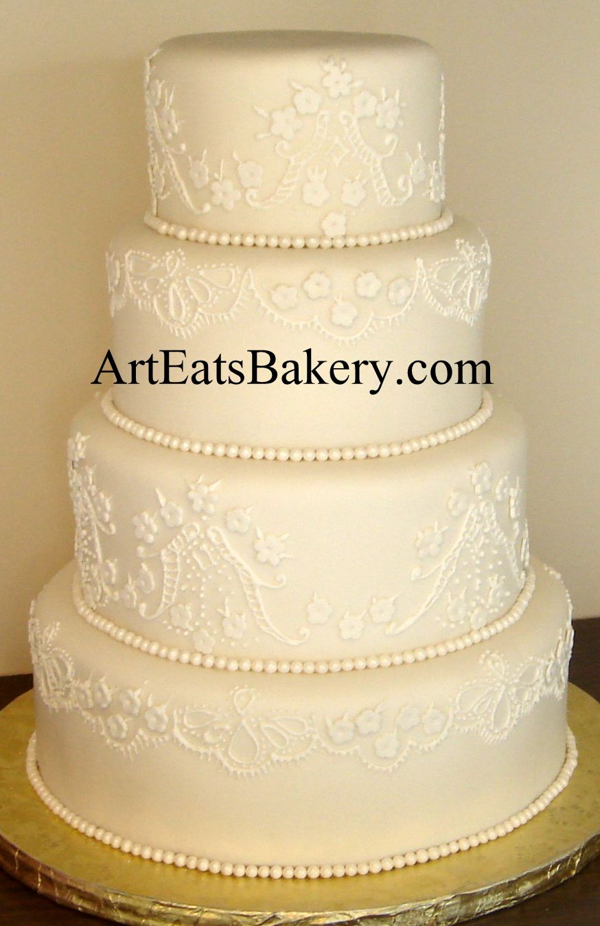 Elegant ivory fondant wedding cake with romantic white flower lace ...