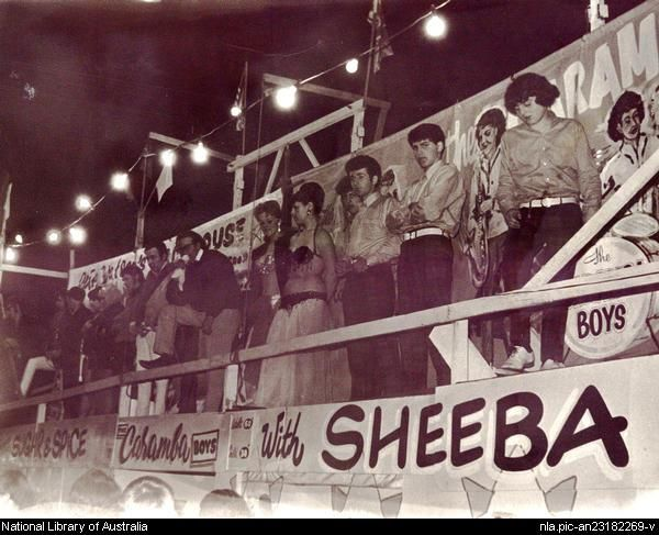 Sugar & Spice and The Carumba Boys with Sheeba on parade outside sideshow tent, ca. 1960.