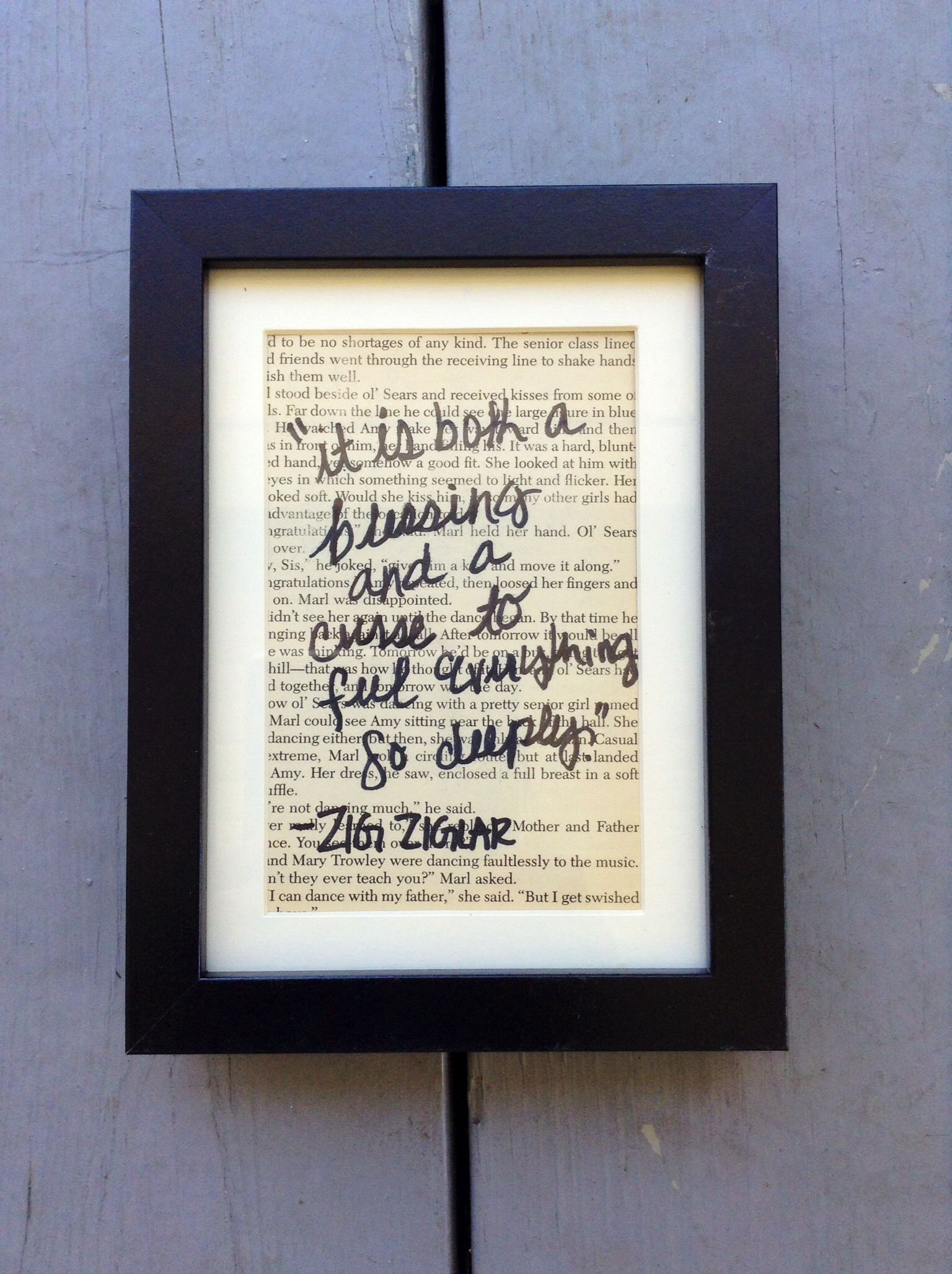 Vintage pages with inspirational quotes in a classic black frame ...
