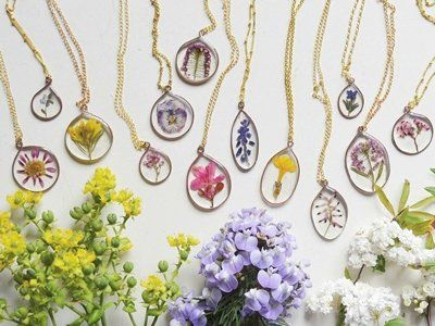 Wearing florals isn't just for spring - when they're sealed in resin like these beauties from Flower and Finch you can dangle them from your limbs any old time.