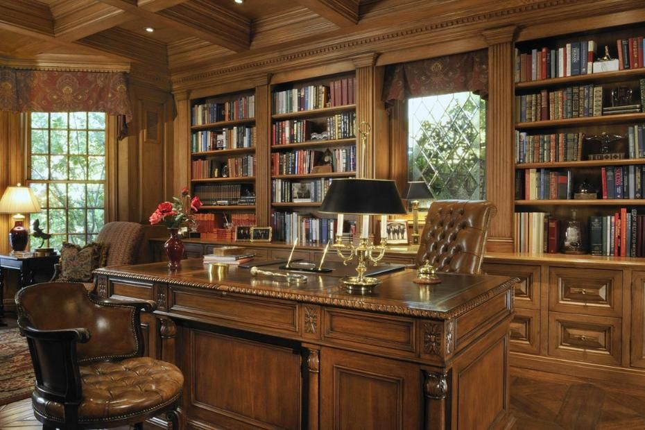 A Private Study With A Large Masculine Desk And Built In