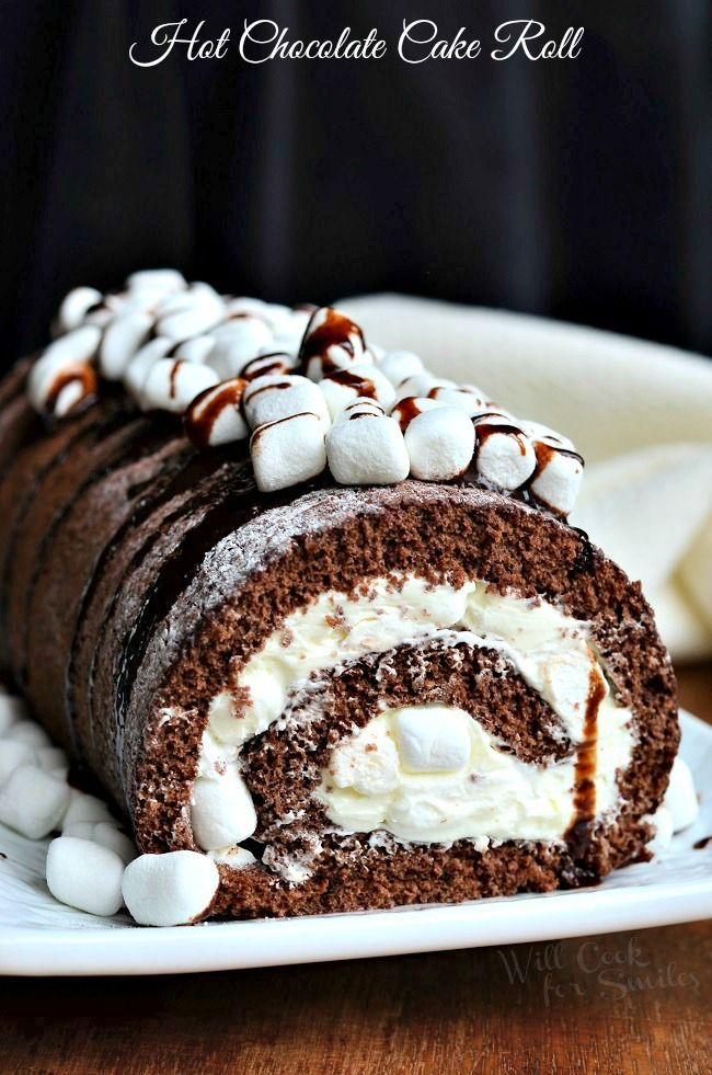 Hot Chocolate Cake Roll. Soft chocolate cake roll filled with light and fluffy frosting with folded mini marshmallows, drizzled with chocolate syrup and topped with more marshmallows. | from willcookforsmiles.com