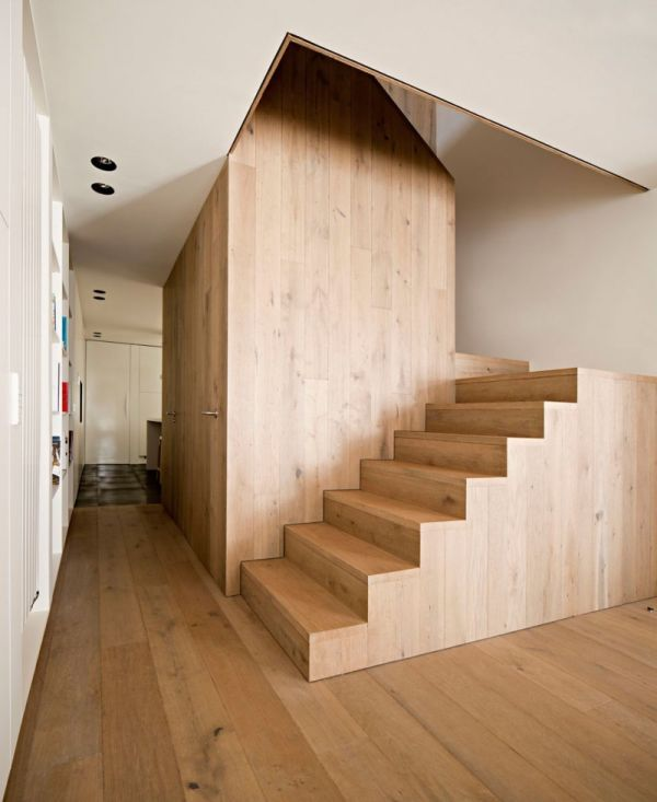 A simple and elegant home with a wooden volume