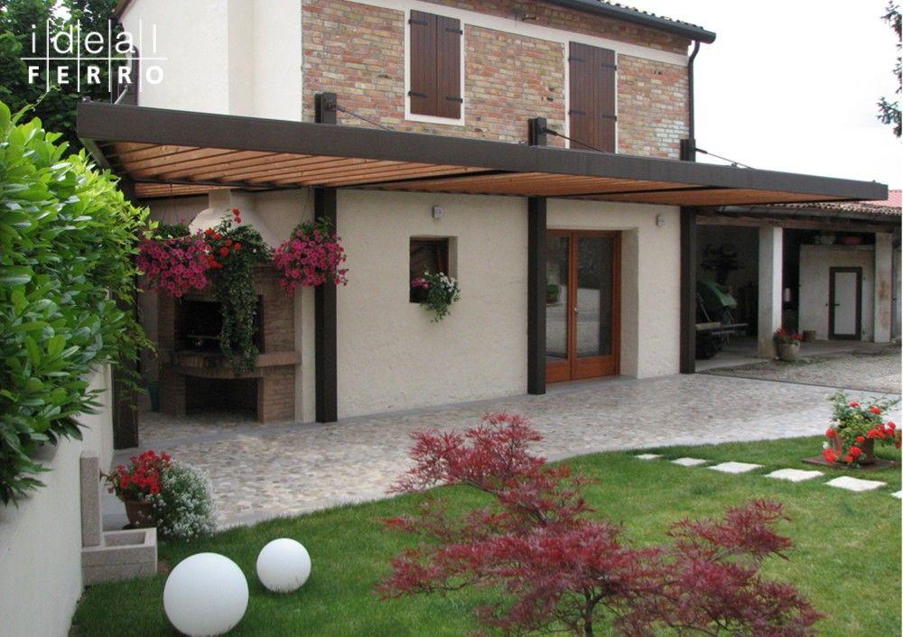Tettoia in ferro e legno architettura protezione for Ville con portico in legno