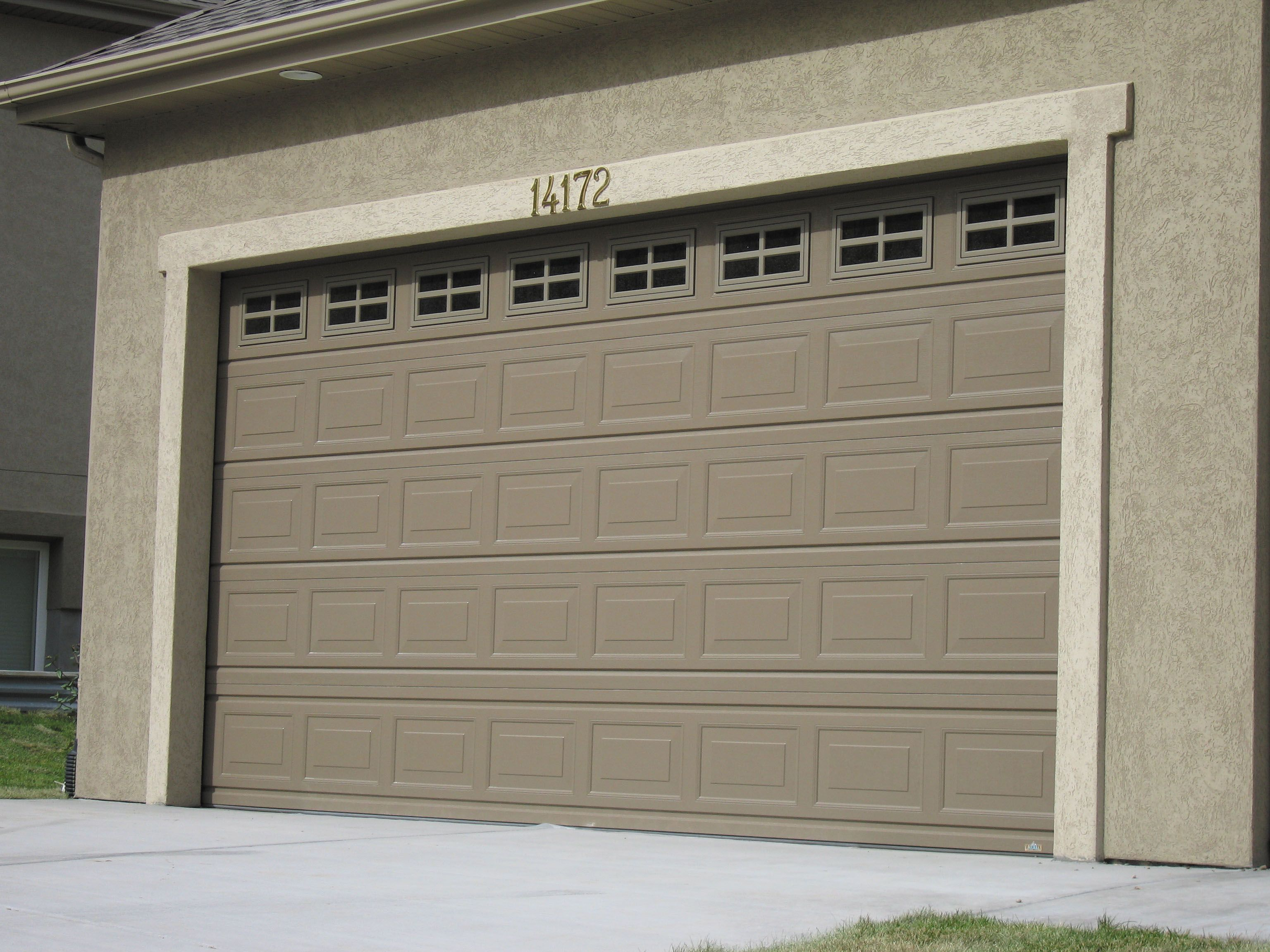 bdb3e92e4a62 Garage door style to match front door windows. Maybe in light almond or desert  taupe.