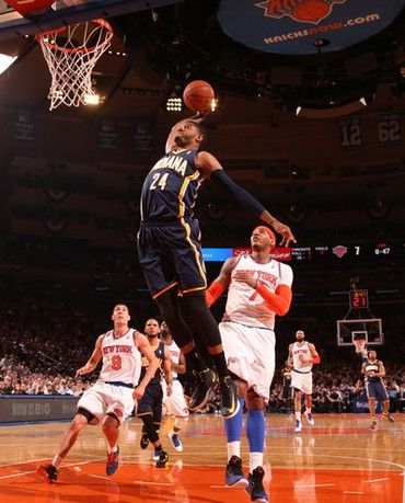 promo code 03fbb 6bd94 Paul George of the Indiana Pacers dunks against Carmelo Anthony of the New  York Knicks in Game Five of the Eastern Conference Semifinals during the  2013 NBA ...
